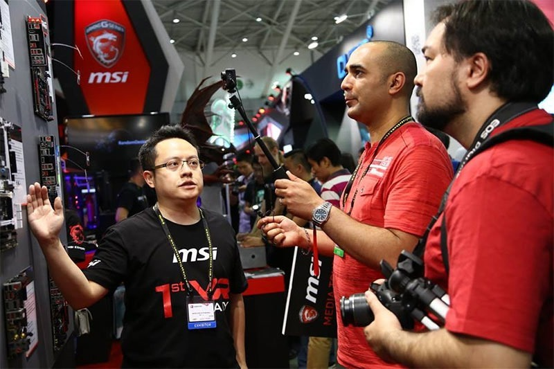 Who is that handsome gentleman being enthralled by MSI's Boards?